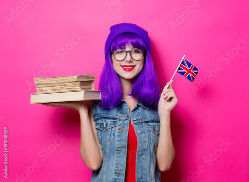 girl with Great Britain flag and books