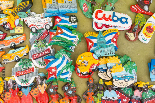 Fotobehang Havana Cuban national flags, palm, Che Guevera portraits and other fridge magnet / souvenirs typical for Cuba sold in souvenir shop in street market in Cienfuegos, Cuba