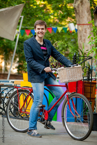 Young man with red bike