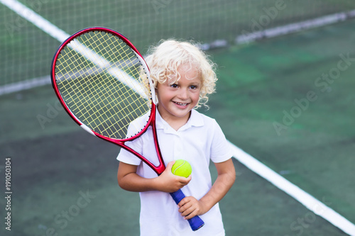 Fotobehang Tennis Child playing tennis on outdoor court