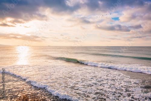 Perfect breaking barrel ocean wave. Landscape with sunrise colors