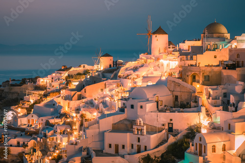 Santorini Oia Greece during vacation with a view at the white washed village with beautiful greek church © Fokke