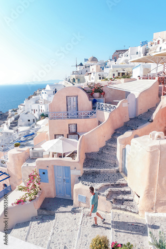 Fotobehang Santorini Santorini Oia Greece during vacation with a view at the white washed village with beautiful greek church