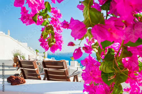 Fotobehang Roze Beautiful terrace with pink flowers. Santorini island, Greece