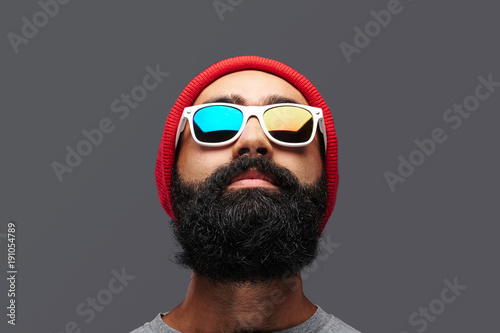 Portrait of a bearded male isolated on grey background.