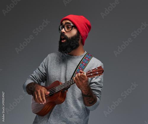 Fotobehang Muziek Portrait of a bearded male isolated on grey background.