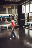 Slim ballerina practicing in studio - 191056102