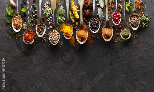 Spices and herbs on  graphite board © Dionisvera