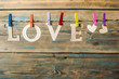 words Love hang with rope on wood background (Valentines day) - 191069568