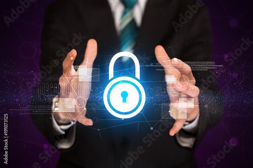 Businessman holding lock graphic