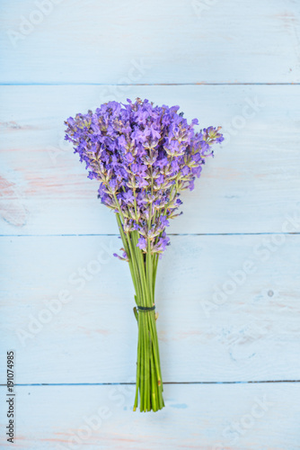 Fotobehang Lavendel Bouquet of lavenders flower on light blue wooden background .
