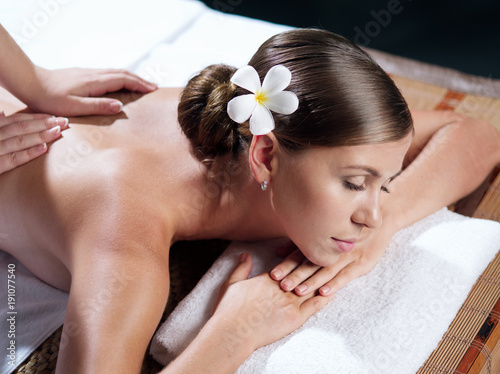 Poster portrait of young beautiful woman in spa environment.