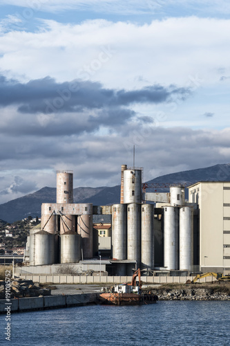 Aluminium Schip Old silos and industrial area in the Imperia harbor (Italy)