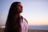 Young Indian woman looking up sunset sky  - 191086596