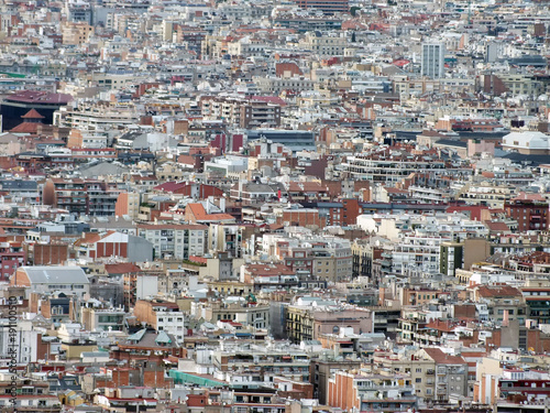 panoramic aerial urban landscape of barcelona showing residential and business districts with hundreds of buildings visible