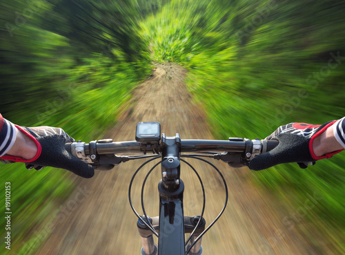 Fast ride in summer forest. Sport and active life concept..