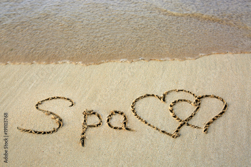 Foto op Plexiglas Spa Word Spa written on the sand and two love heart.