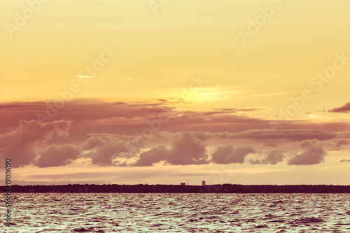 Fotobehang Zee zonsondergang Beautiful seascape evening Baltic sea sunset horizon and cloudy sky. Tranquil landscape scene.
