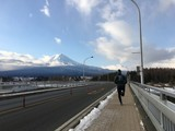 Rear view of man running towards Mt. Fuji