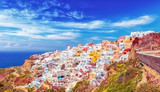Island Santorini in Aegean sea in Greece. Volcano village Oia. Sunset scenery.