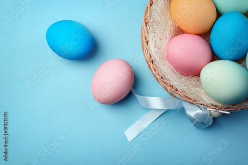 Dyed Easter eggs on color background
