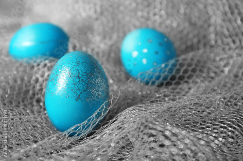 Dyed Easter eggs on grey fabric