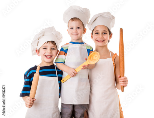 Fotobehang Koken Three young chefs standing together with ladle and rolling pin