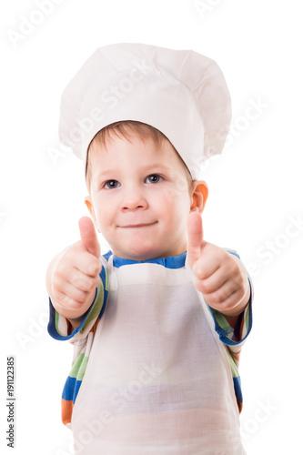 Fotobehang Koken Little cook showing thumb up sign
