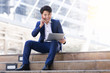 Asian businessman smile work happy relaxation with laptop in city