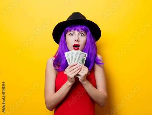 hipster girl with purple hairstyle with money