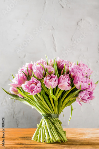 pink tulips on wood board
