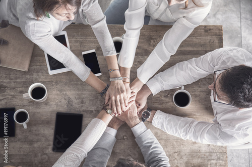 Group of people hands up together
