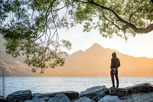 Fotobehang Bleke violet Young male photographer looking at sunset in Queenstown