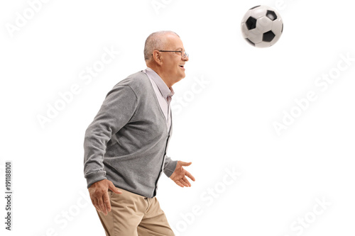Fotobehang Voetbal Senior playing with a football