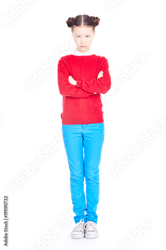 Portrait of cute Asian school girl in red sweater and blue jeans with double buns on her head posing on white background