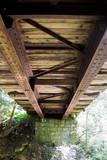 Old wooden bridge bottom view