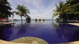 Luxury hotel,resort near at sea with pool among the palm trees. Luxurious open air swimming pool at resort. Swimming pool with turquoise water in hotel. Travel concept. - 191204571