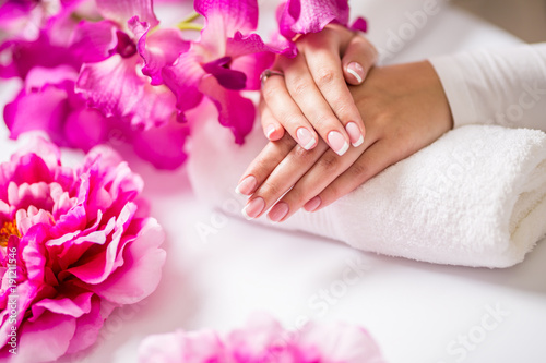 Poster Manicure Closeup shot of beautiful female dands with nails of france manicure. Manicure and spa concept