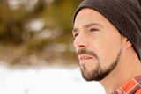 Pensive man with beard,plaid t-shirt,hat and casual clothes. A young and carefree lifestyle. - 191216597