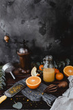 close up view of orange pieces and juice in bottle on wooden tabletop - 191217742