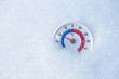 Outdoor thermometer in snow shows minus 20 Celsius degree cold winter weather concept