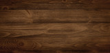Dark stained wood boards with grain and texture. Flat wood background with parallel horizontal lines. - 191225191