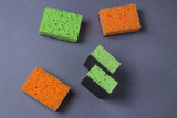 Orange and green sponges for dishes on grey background - 191231374