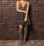 Attractive Woman in a Summer Dress and Knee High Cowboy Boots - 191236170