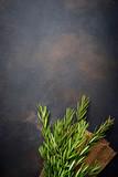 Bunch of fresh rosemary on dark background - 191238745