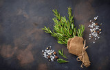 Bunch of fresh rosemary on dark background - 191238952