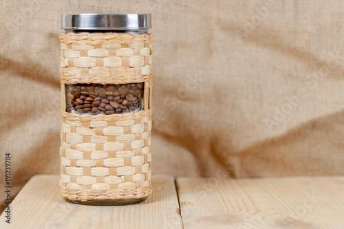 Papiers peints Café en grains coffee in a glass jar in a wicker case