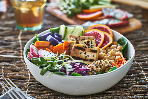 colorful buddha bowl with grilled tofu and pea shoots - 191240175