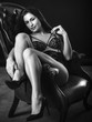 Sexy woman sitting on leather chair
