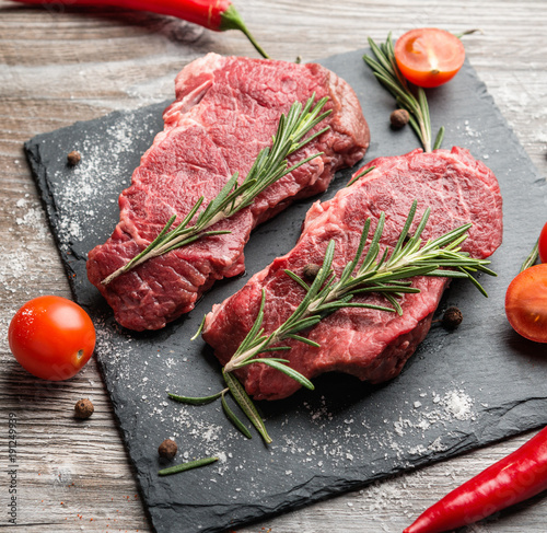 Aluminium Steakhouse Raw beef fillets with spices